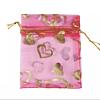 Cadeau Verpakking Organza Donkerroze met Goudkleurige Hartjes