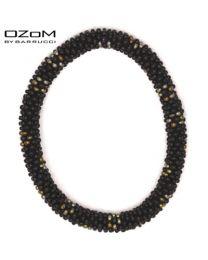 OZOM by Barrucci Roll-On Bracelet Black/Gold Flowers -